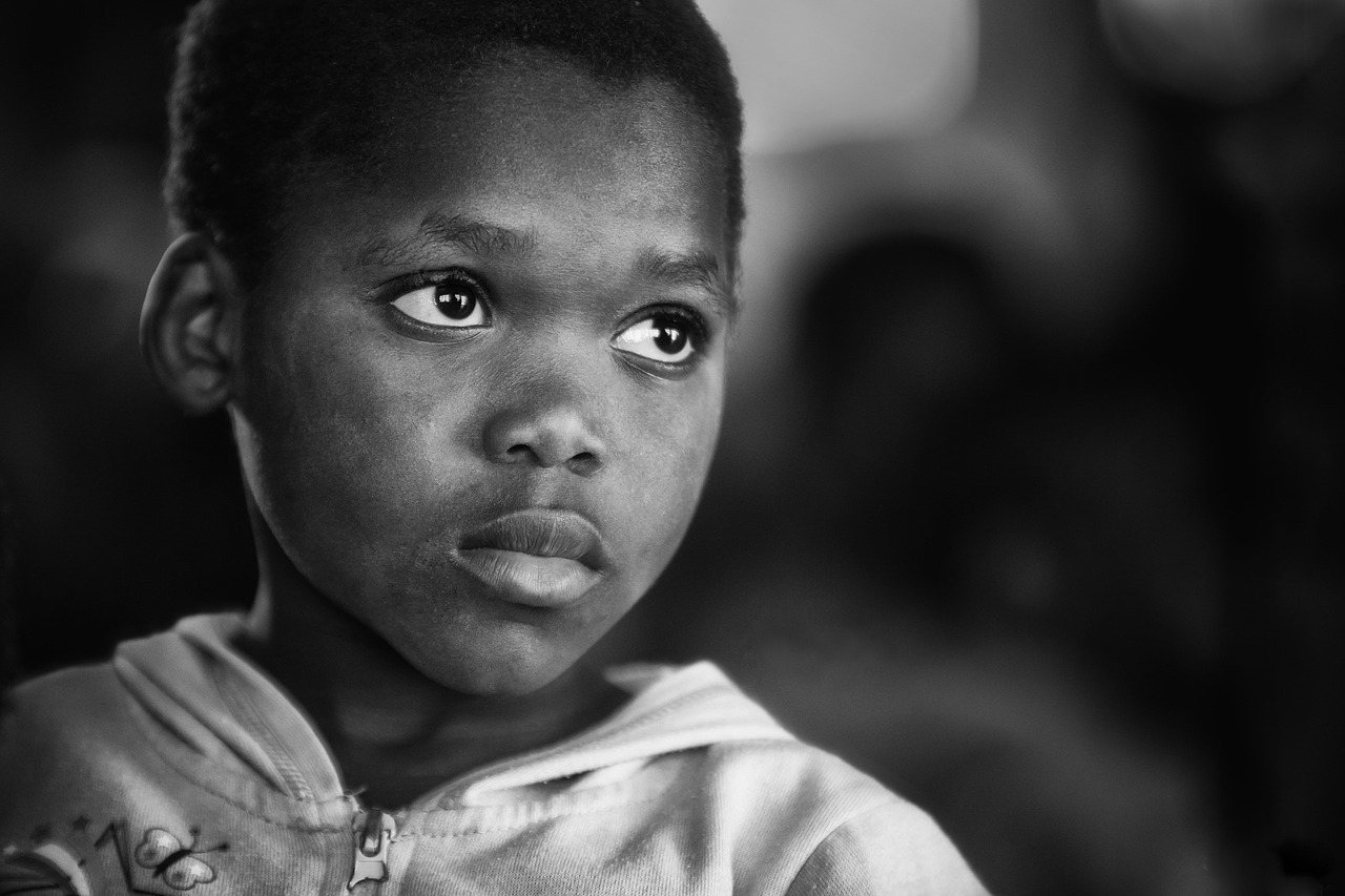 Orphaned African child living in poverty.
